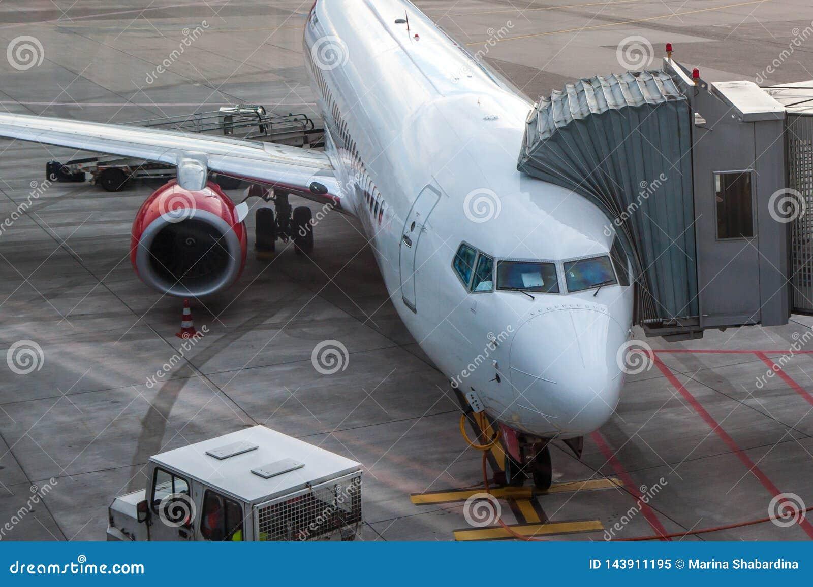 Passenger aircraft loads passengers before the flight
