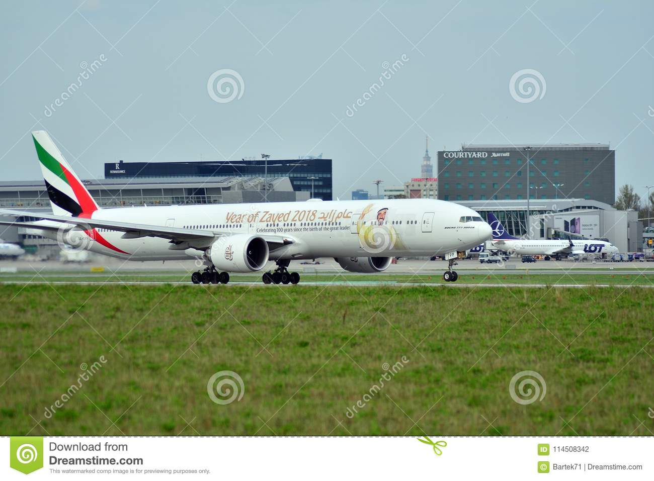 Passenger airplane Boeing 777-300 ER Emirates Airlines is flying from the runway of Warsaw Chopin Airport