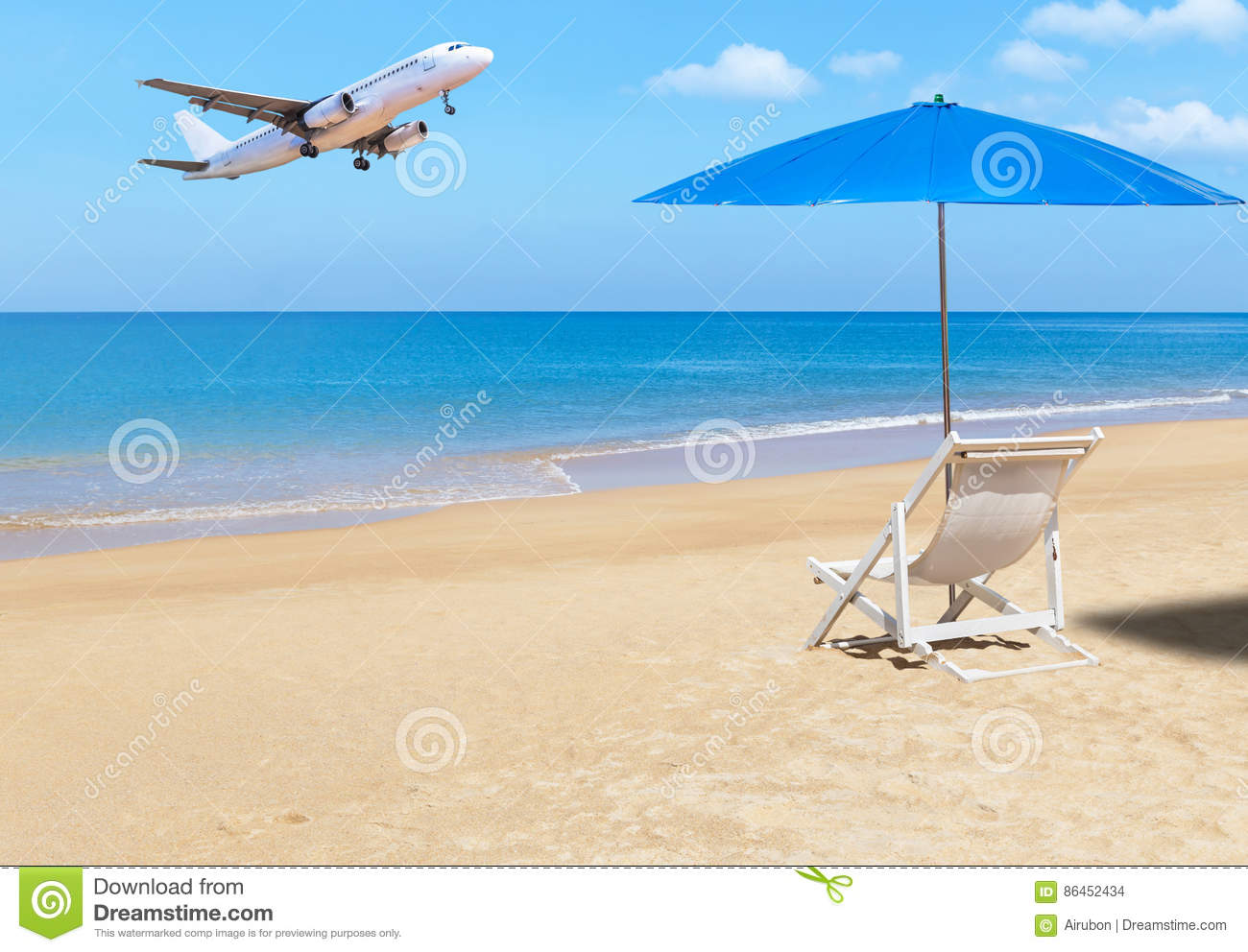 White wooden beach chair - Passenger Airplane Landing Above Tropical Beach With White Wooden Beach Chair And Blue Parasol Stock Photo