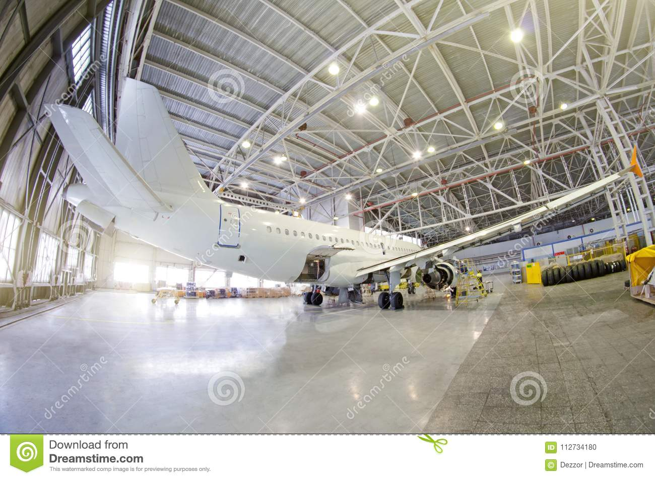 Passenger airplane on maintenance of engine, fuselage and on auxiliary power unit. check repair in airport hangar. Aircraft view t
