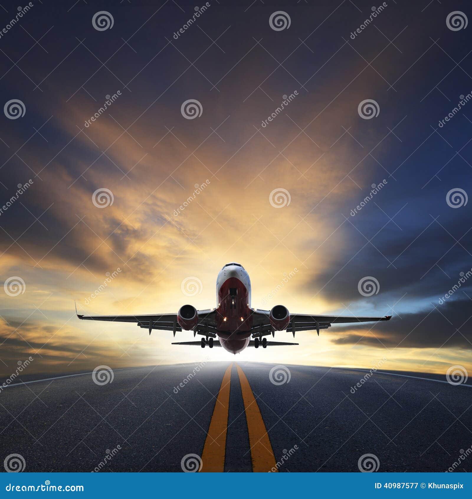 Passenger plane take off from runways against beautiful dusky sk