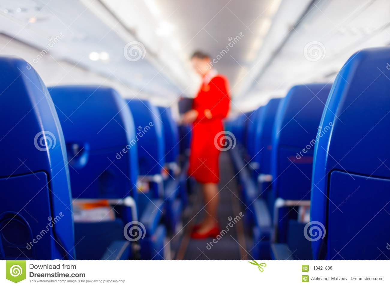 Passenger seat in airplane, Interior of airplane and stewardess background. Stewardess renders services for passengers.