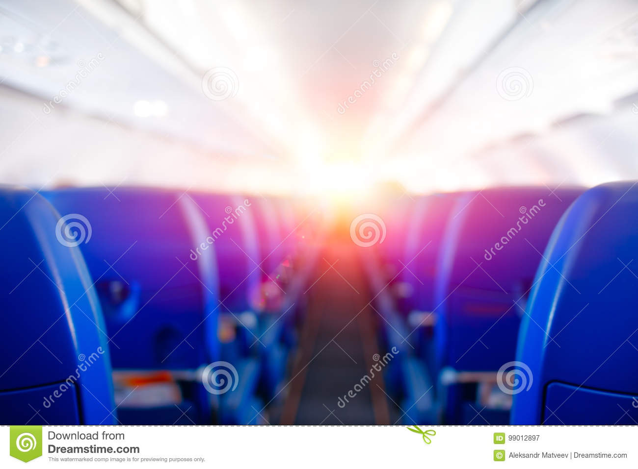 Passenger seat, Interior of airplane, plane flies to meet sun, bright sunlight illuminates the aircraft cabin, travel concept