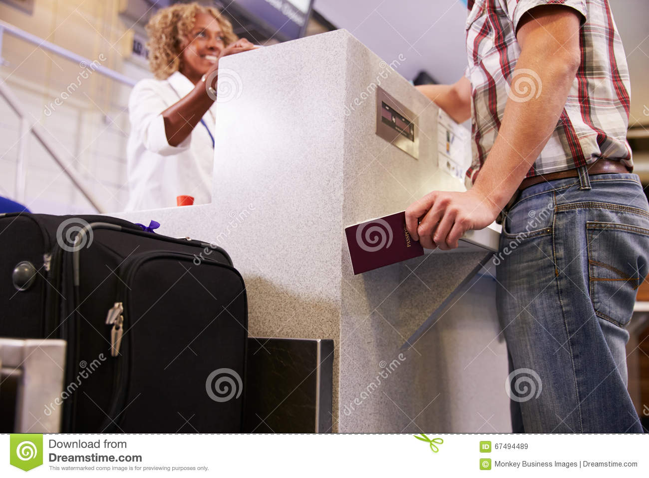 Passenger Weighing Luggage At Airport Check In