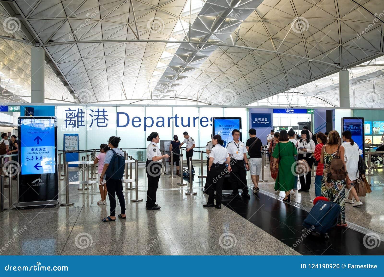 Passengers Carries Luggage At Hong Kong International