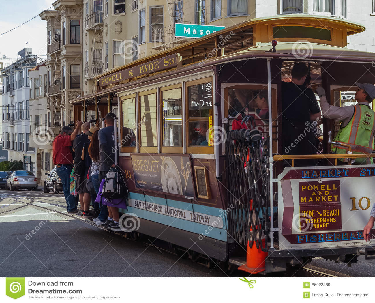 Passengers Ride In A Cable Car In San Francisco Usa