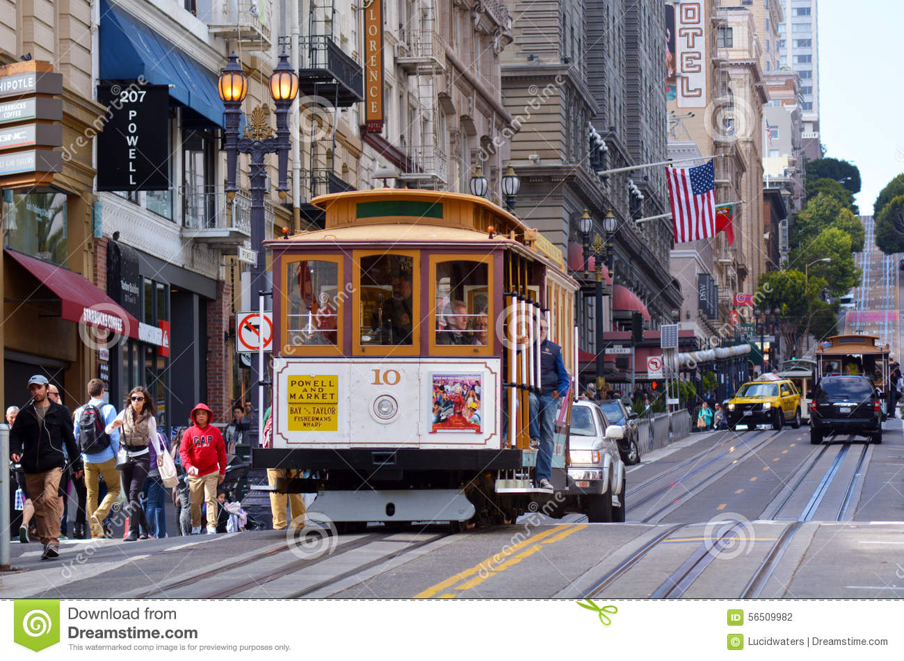 Passengers Riding On Powell Hyde Line Cable Car In San Francisco