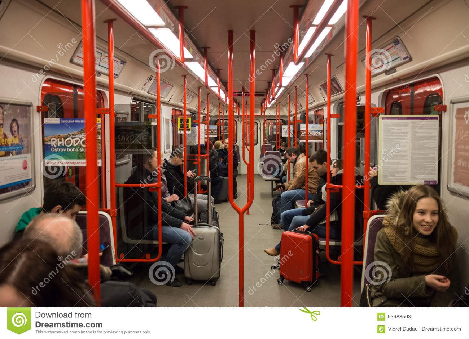 Passengers in subway train interior