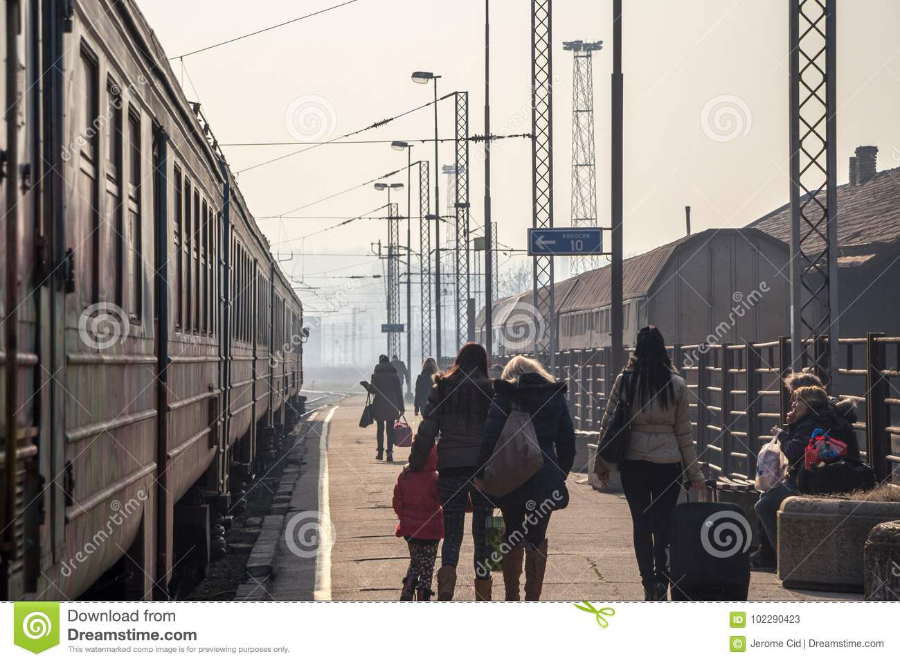 Passengers Waiting To Board A Train On The Platform Of