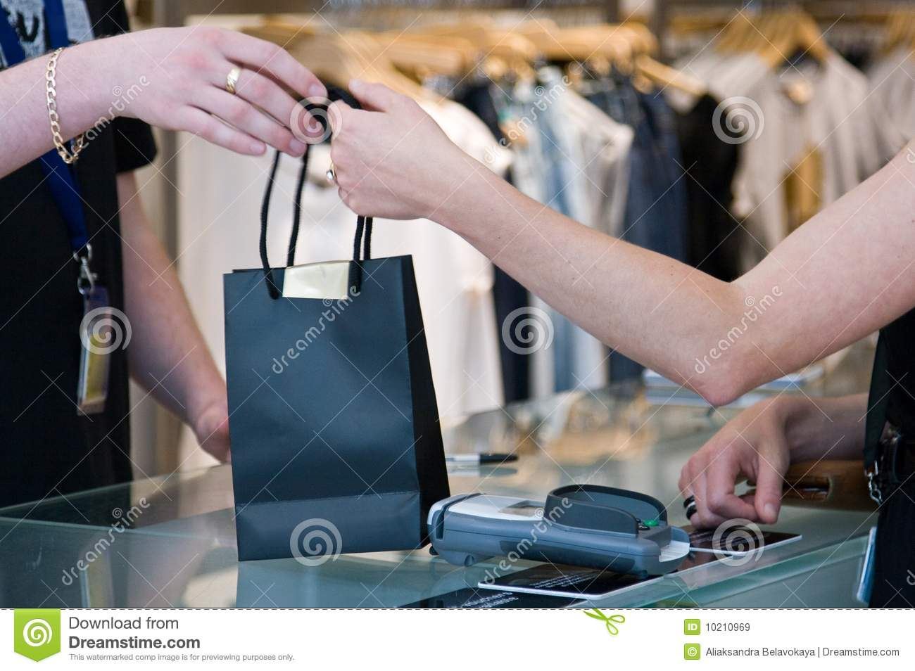 Passing the shopping bag