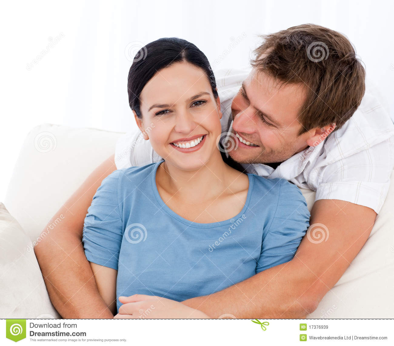 Passionate man hugging his girlfriend