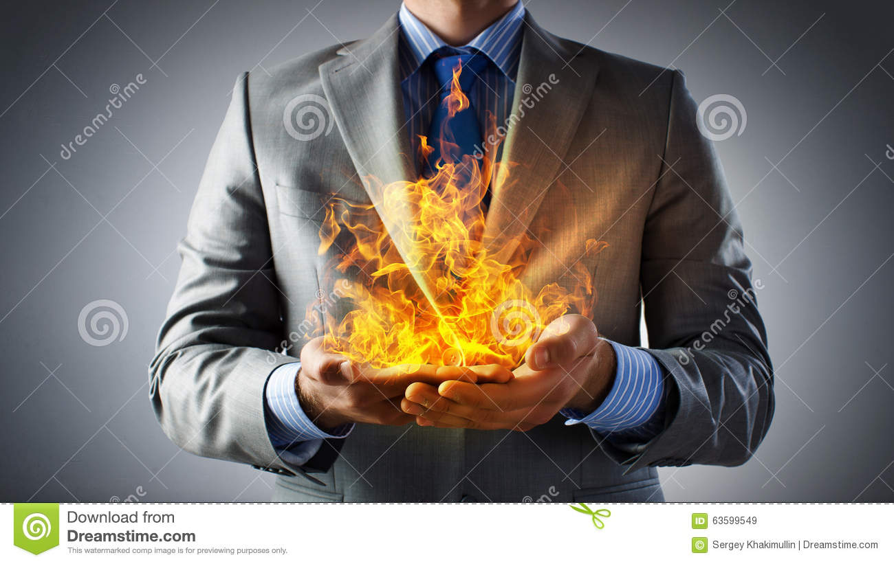 Businessman Hands Holding Fire Flames In Palms Royalty Free Stock Images