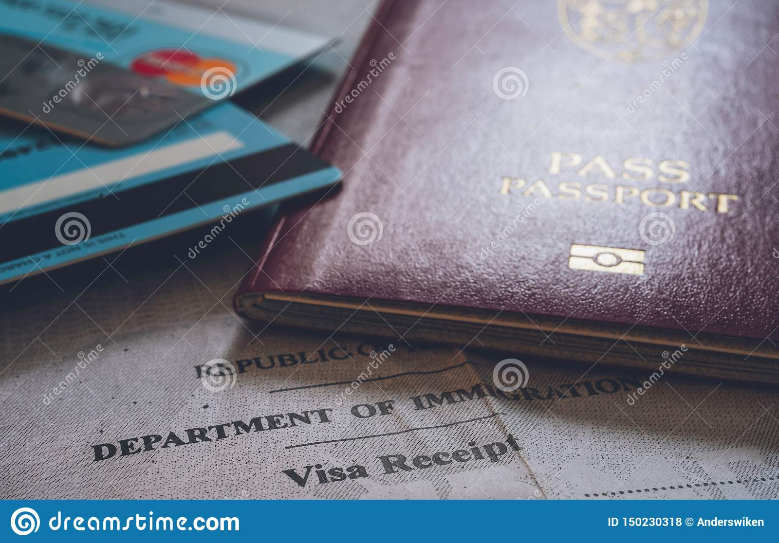 Passport document, banking cards and Immigration card receipt.