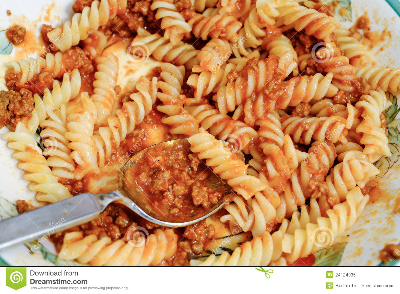 Pasta spirals with bolognese sauce.