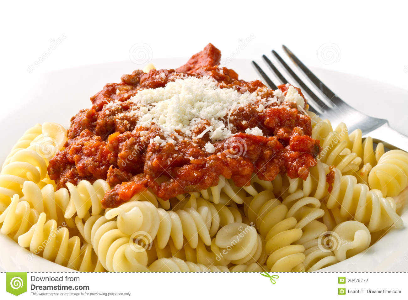 Pasta with bolognese sauce with tomatoes, meat and parmesan cheese.