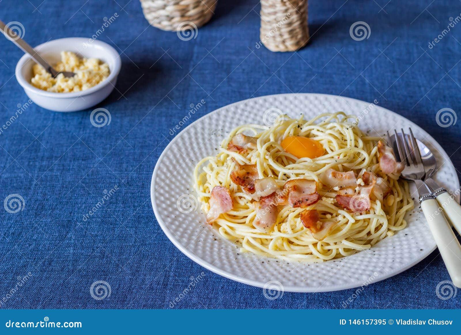 Pasta Carbonara on a blue background. Italian food
