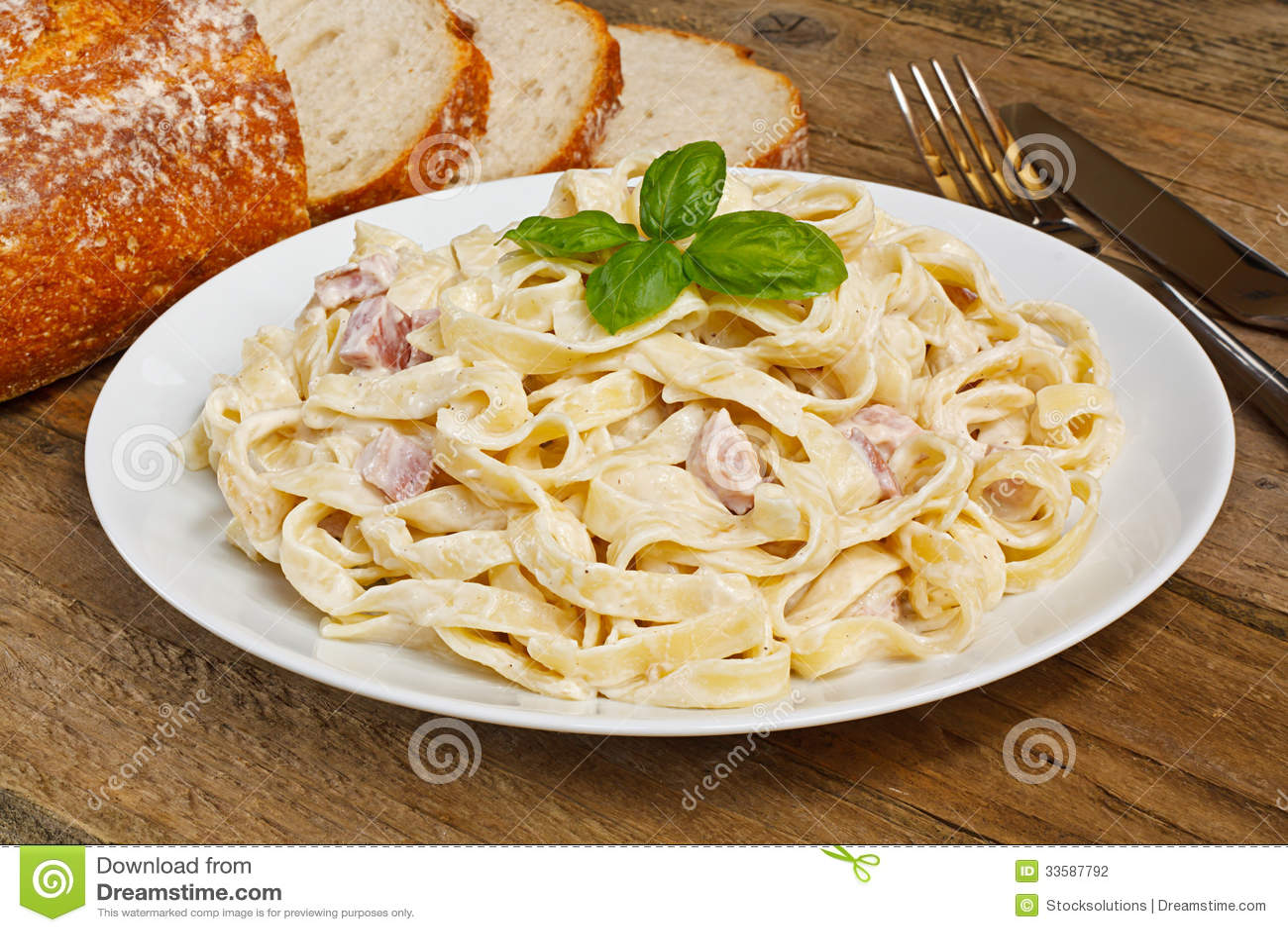 pasta carbonara plate tagliatelli italian food rustic restaurant setting 33587792