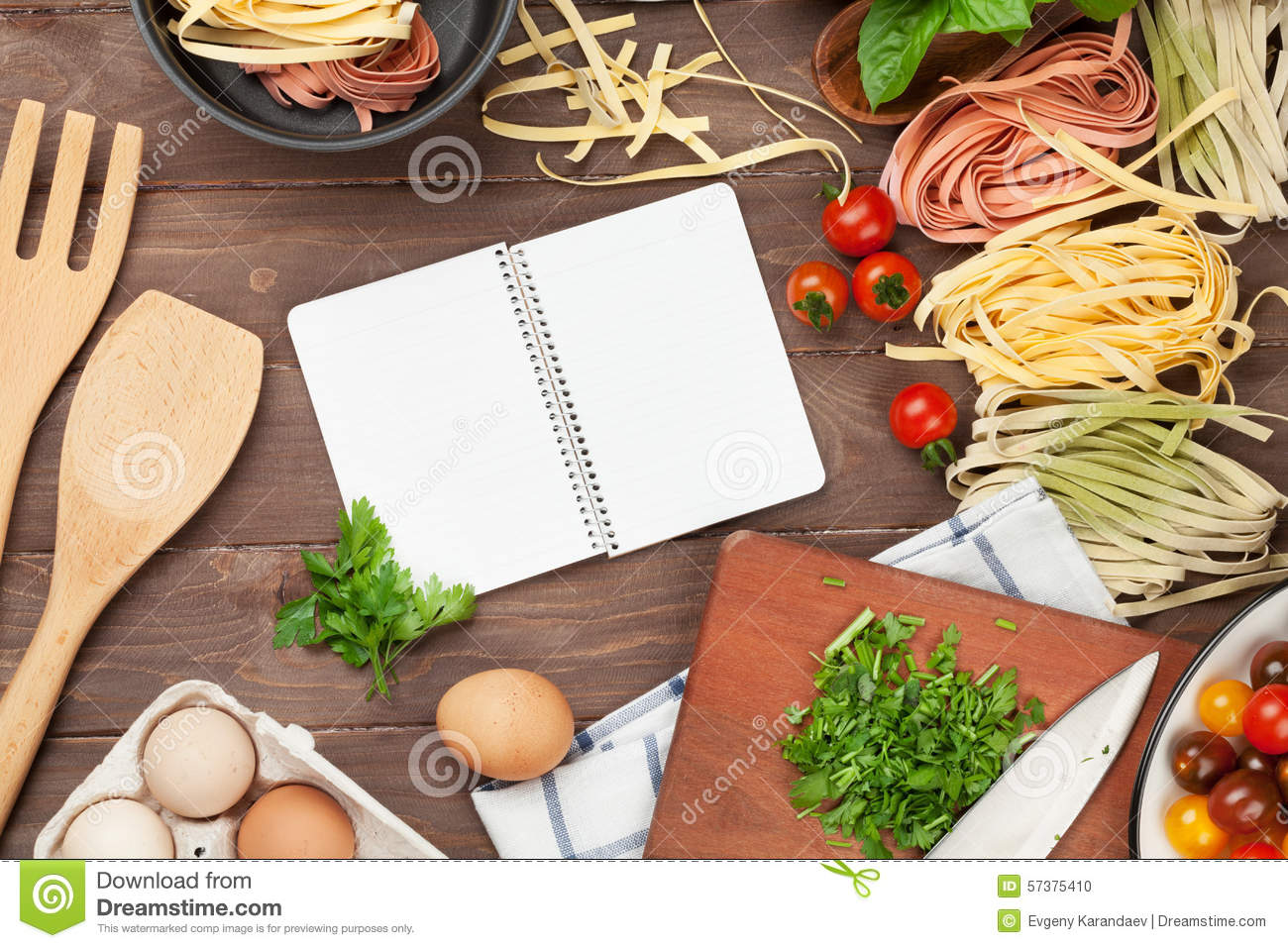 Pasta cooking ingredients and utensils on wooden table for Table utensils
