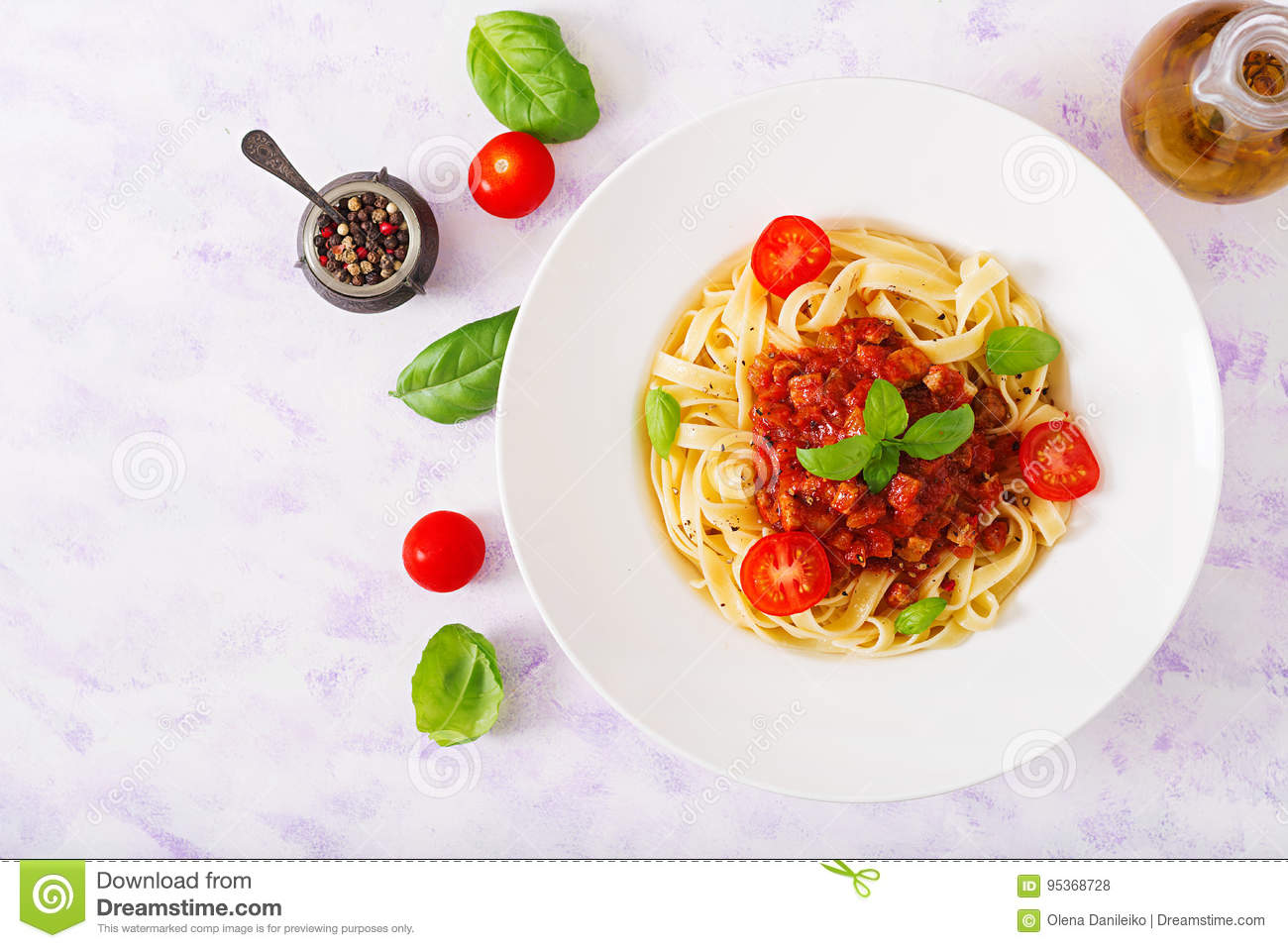 Pasta Fettuccine Bolognese with tomato sauce in white bowl