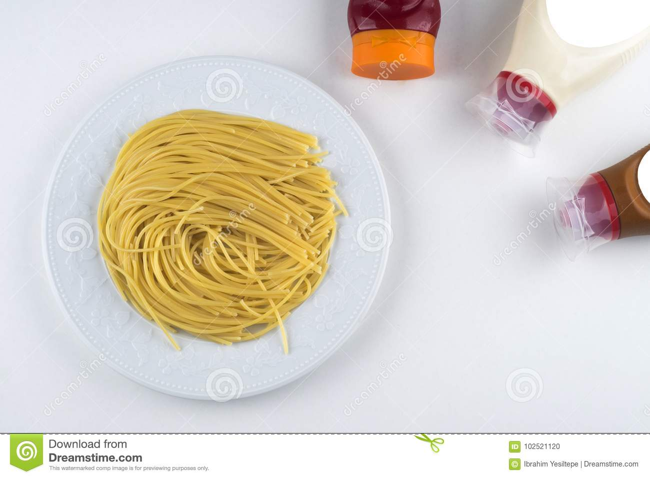 Pasta Fettuccine Bolognese with tomato sauce in white bowl. Top view