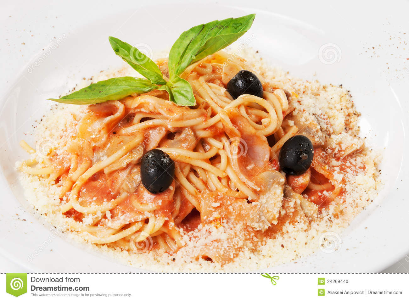 Pasta with ham, mushrooms, olive, basil leaf and parmesan, on white ...