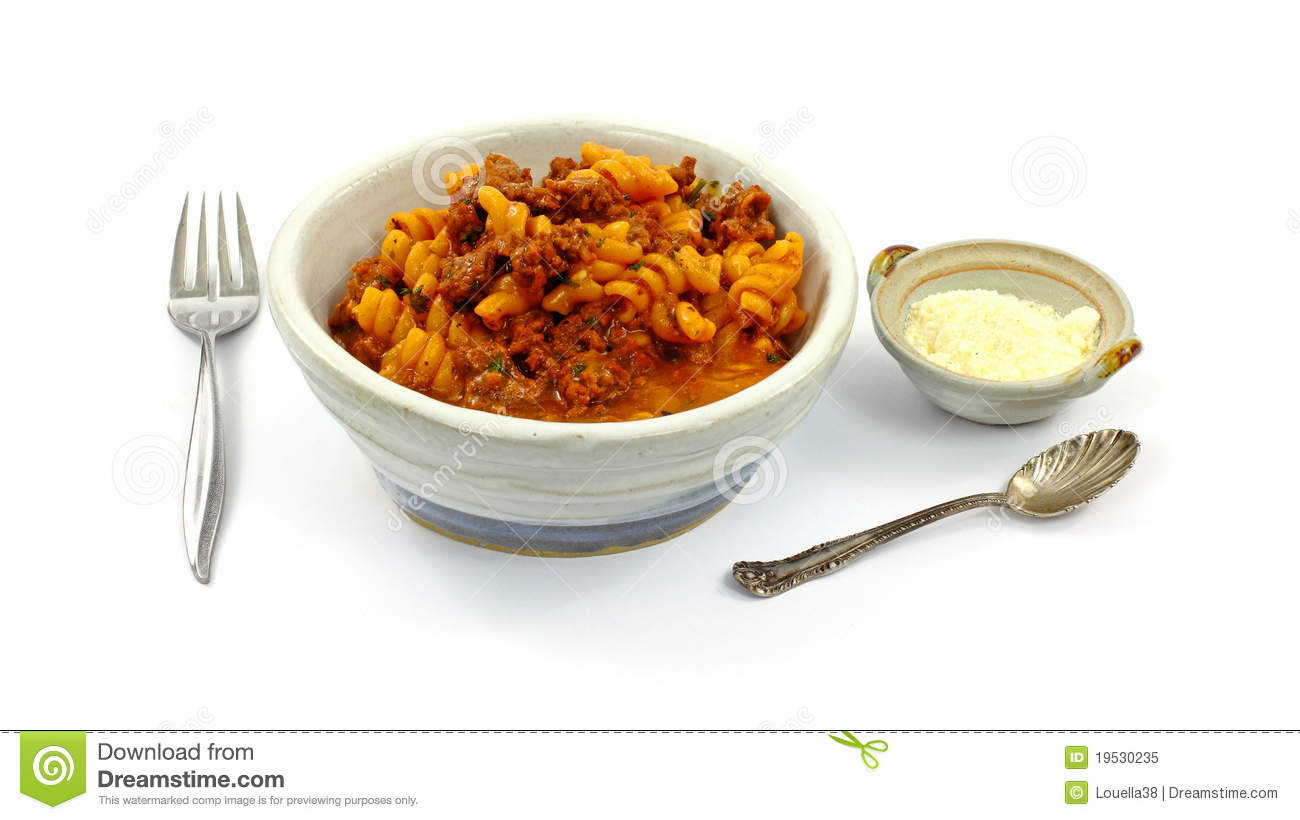 An appetizing filling meal of pasta, hamburg with tomato sauce.