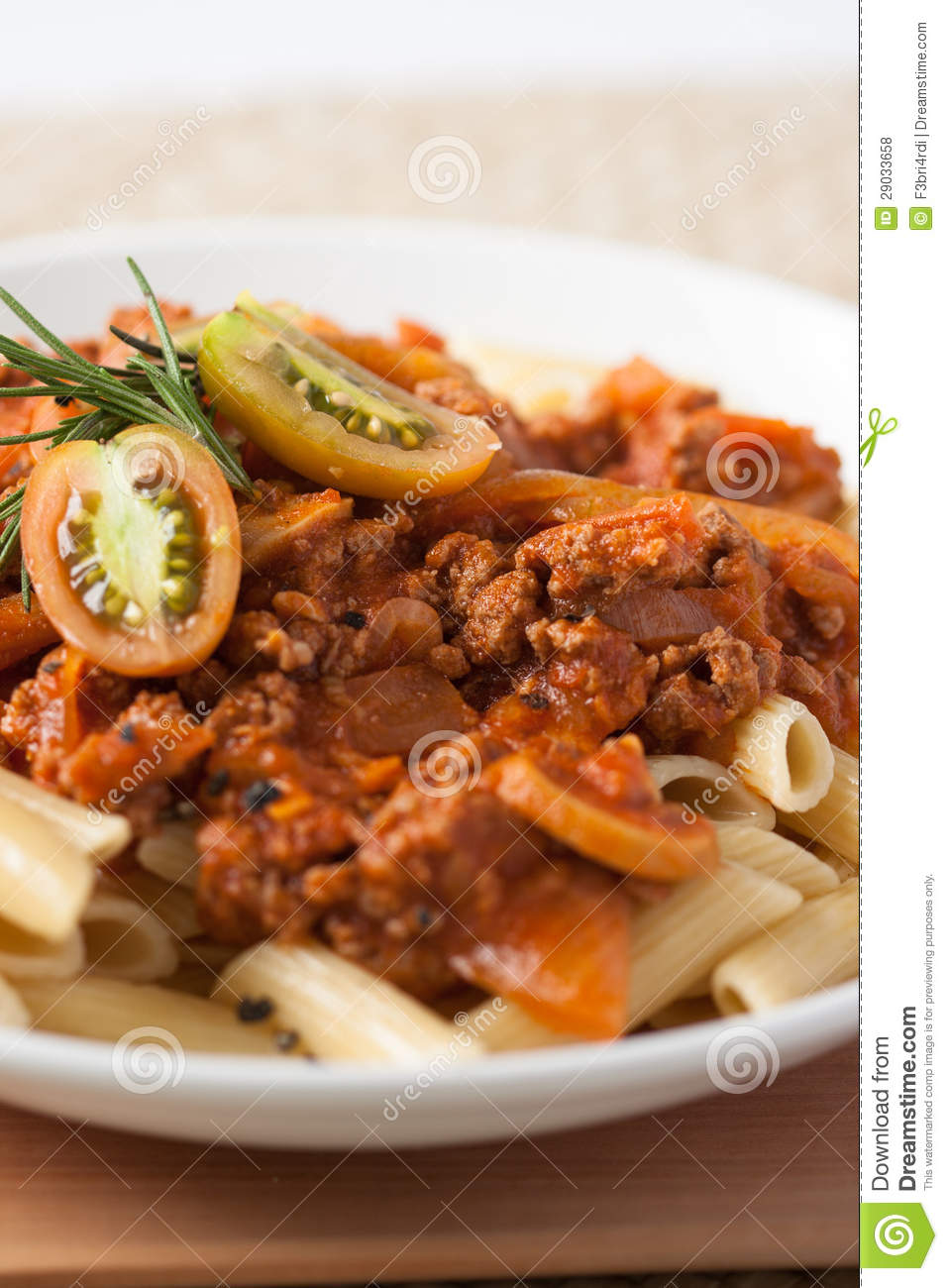 Plate of pasta penne bolognese meat tomato sauce with fresh tomato and ...