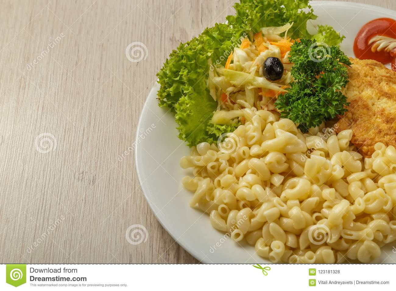 Pasta with a piece of grilled meat and salad.