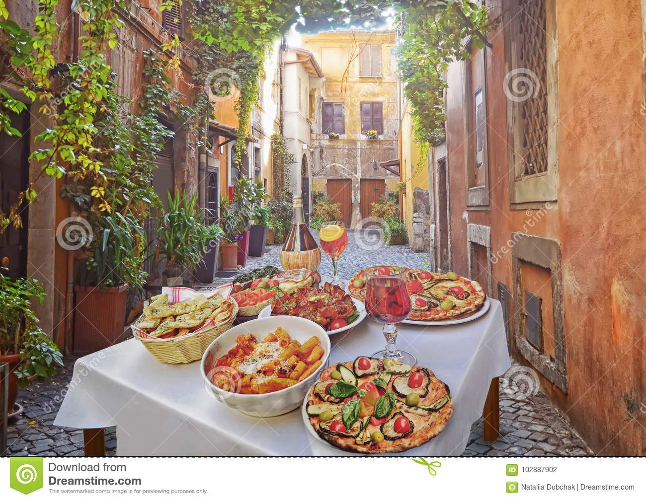 Pasta , pizza and homemade food arrangement in a restaurant Rome
