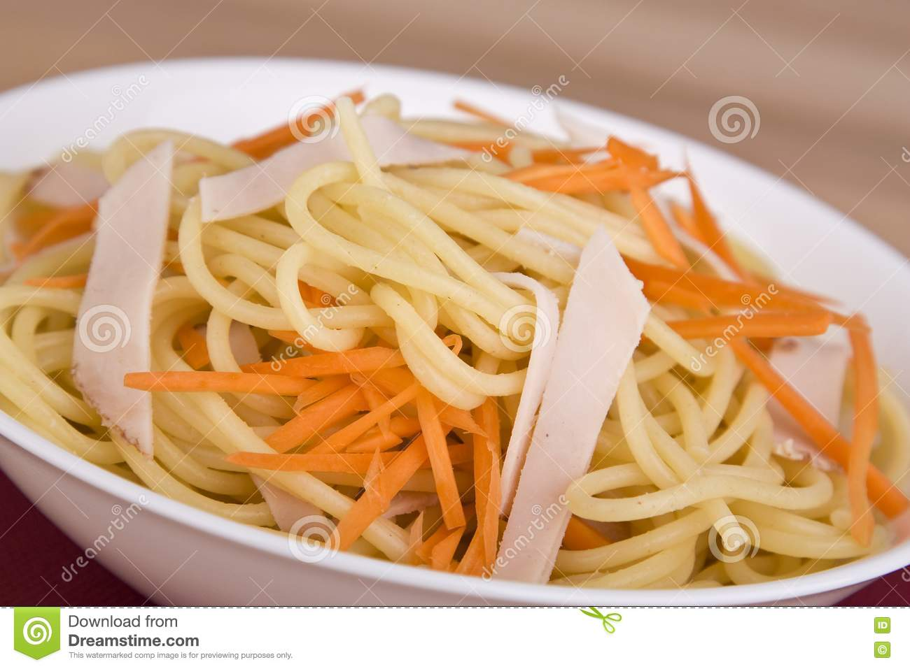Stock Image: Pasta salad with carrot and meat