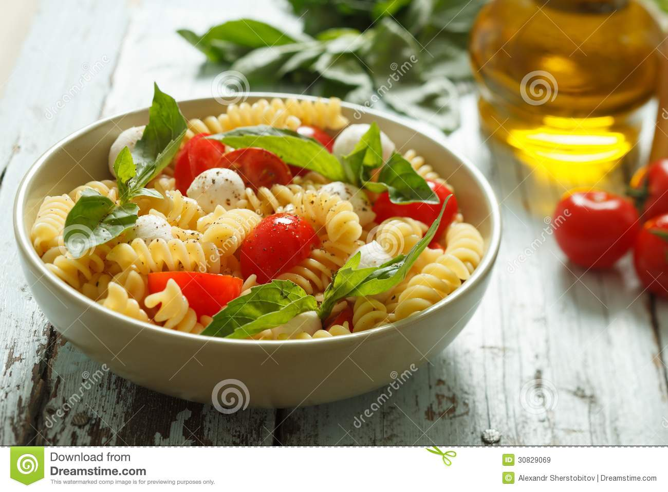 Pasta Salad With Cherry Tomatoes And Basil Leaves Royalty ...