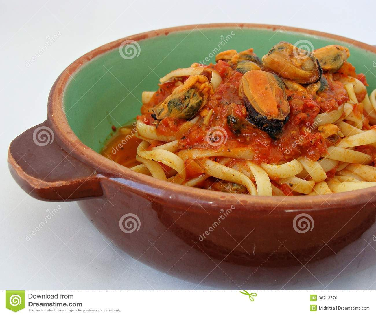 Shelled mussels with pasta and a homemade spaghetti sauce.
