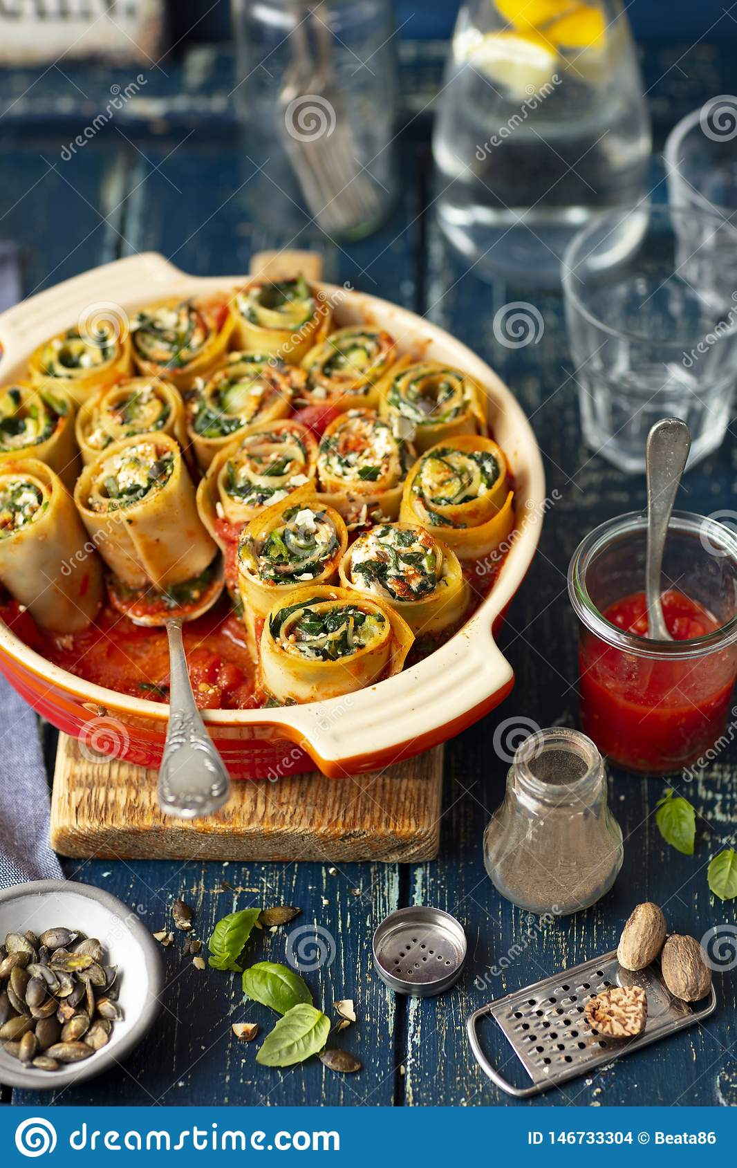 Pasta snails made with lasagne and stuffed with spinach and feta cheese