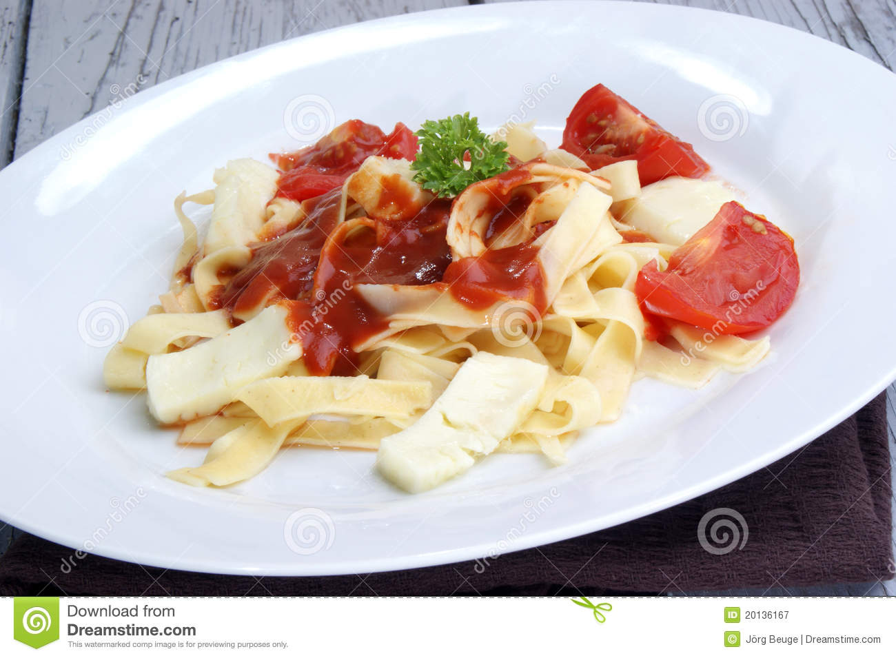 ... Free Stock Photography: Pasta with tomato sauce and baked goat cheese