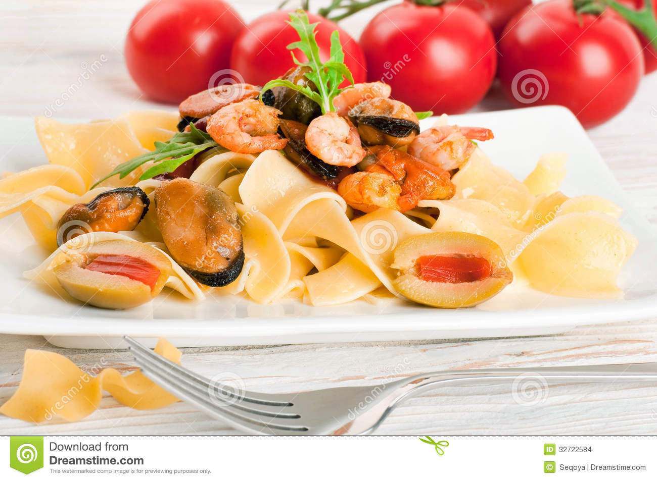 Pasta with tomato and seafood, mussels and shrimp.