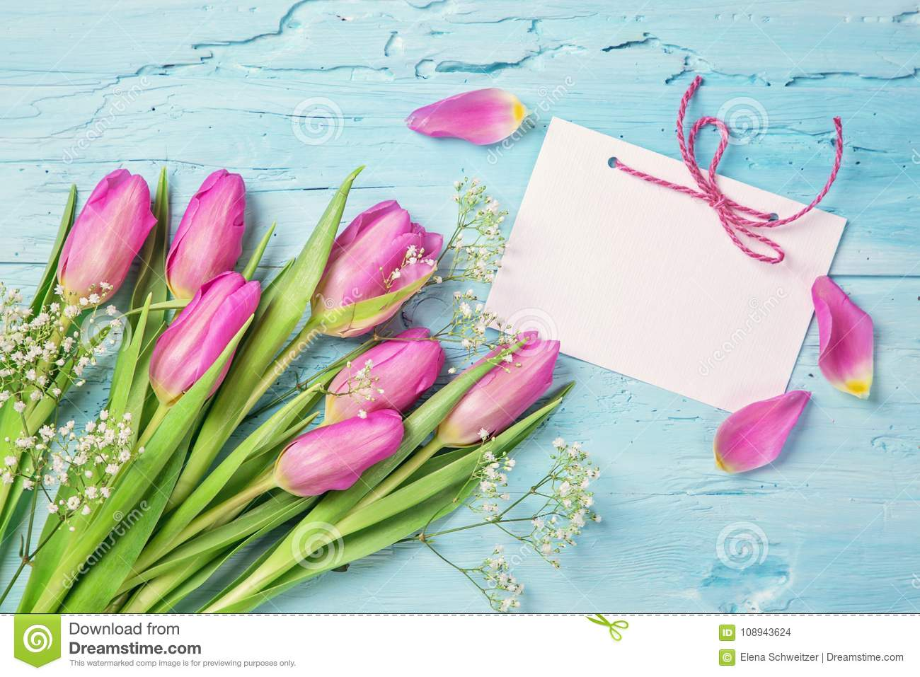 Pastel colored flowers and a card for your text