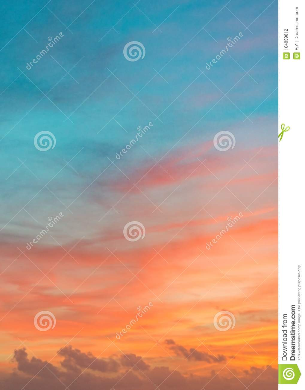 Pastel colors ocean sunset, warm and cyan clouds sky