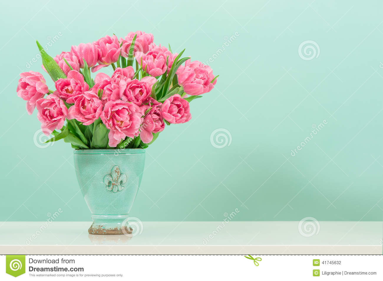Pastel pink tulip flowers over turquoise stock photo for Pastel colored flower arrangements