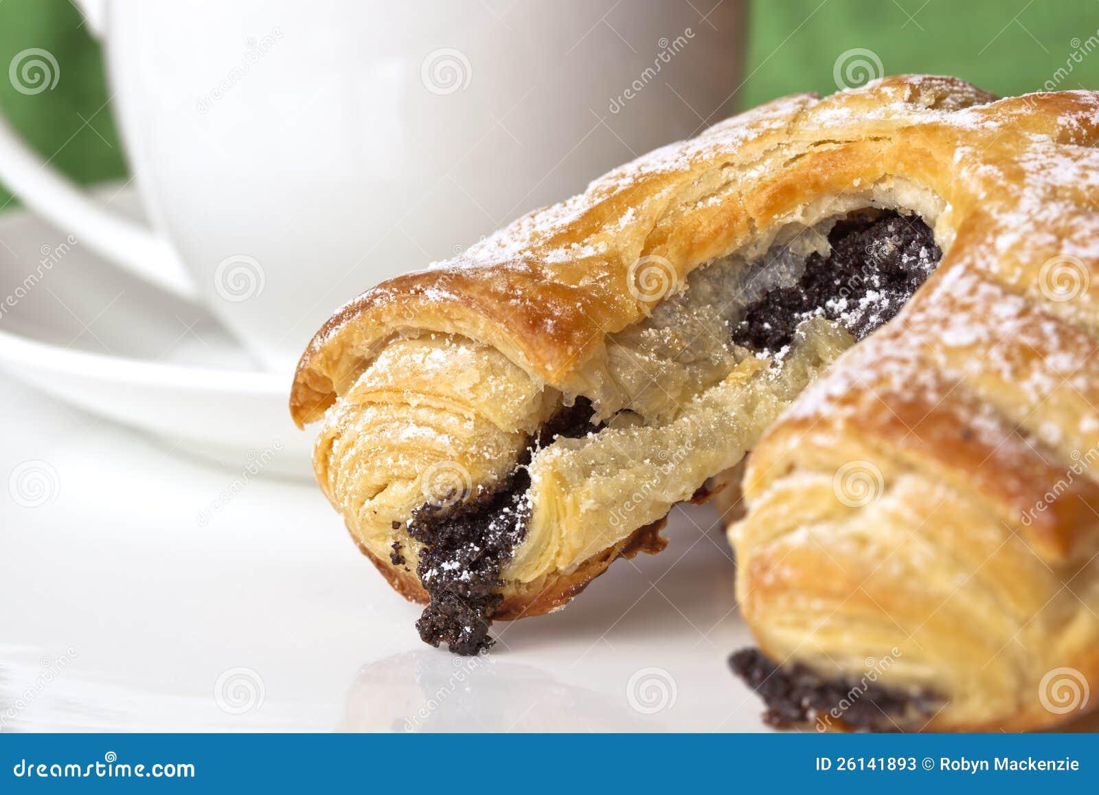Pasteles y café del germen de amapola