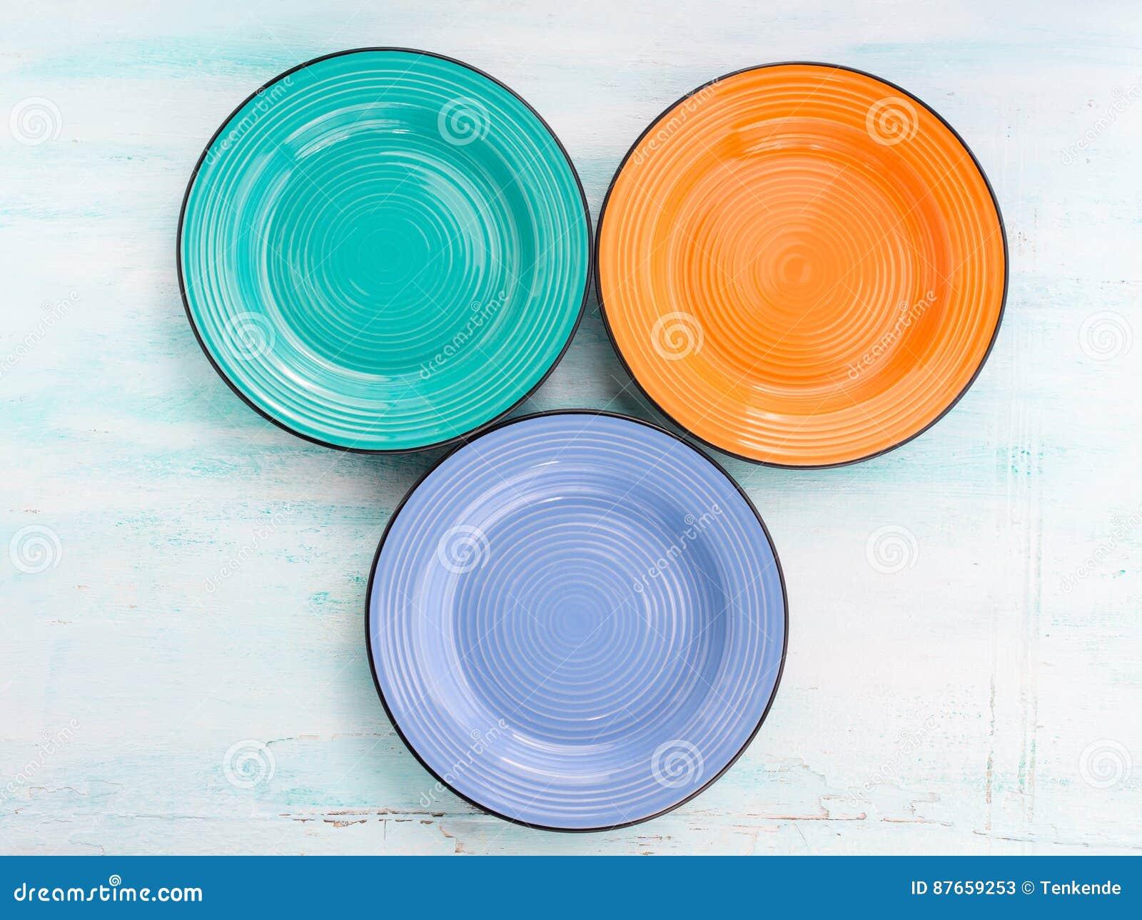 Pastelowego koloru naczynia odgórnego widoku ceramiczny półkowy tło