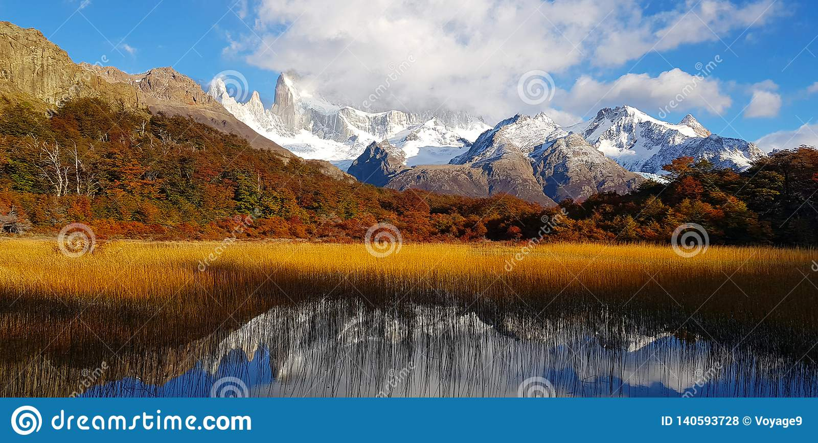 Patagonian autumn colors. Laguna Capri and Mount Fitz Roy covered by clouds, Argentina