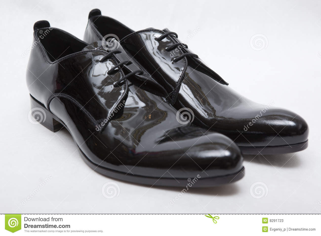 Men's patent-leather shoes on white