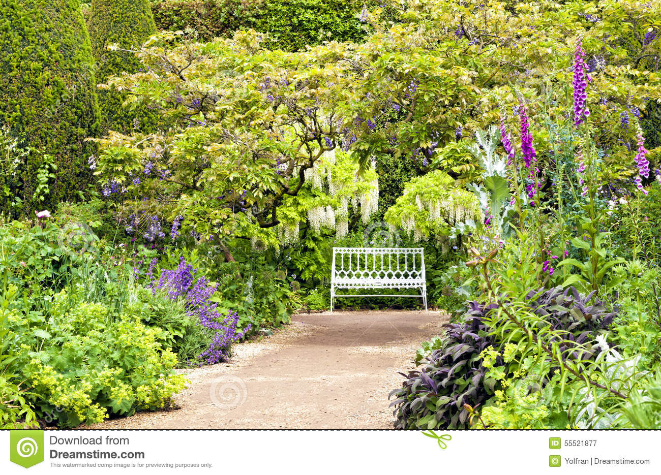 Path Leading To White Bench In English Cottage Garden
