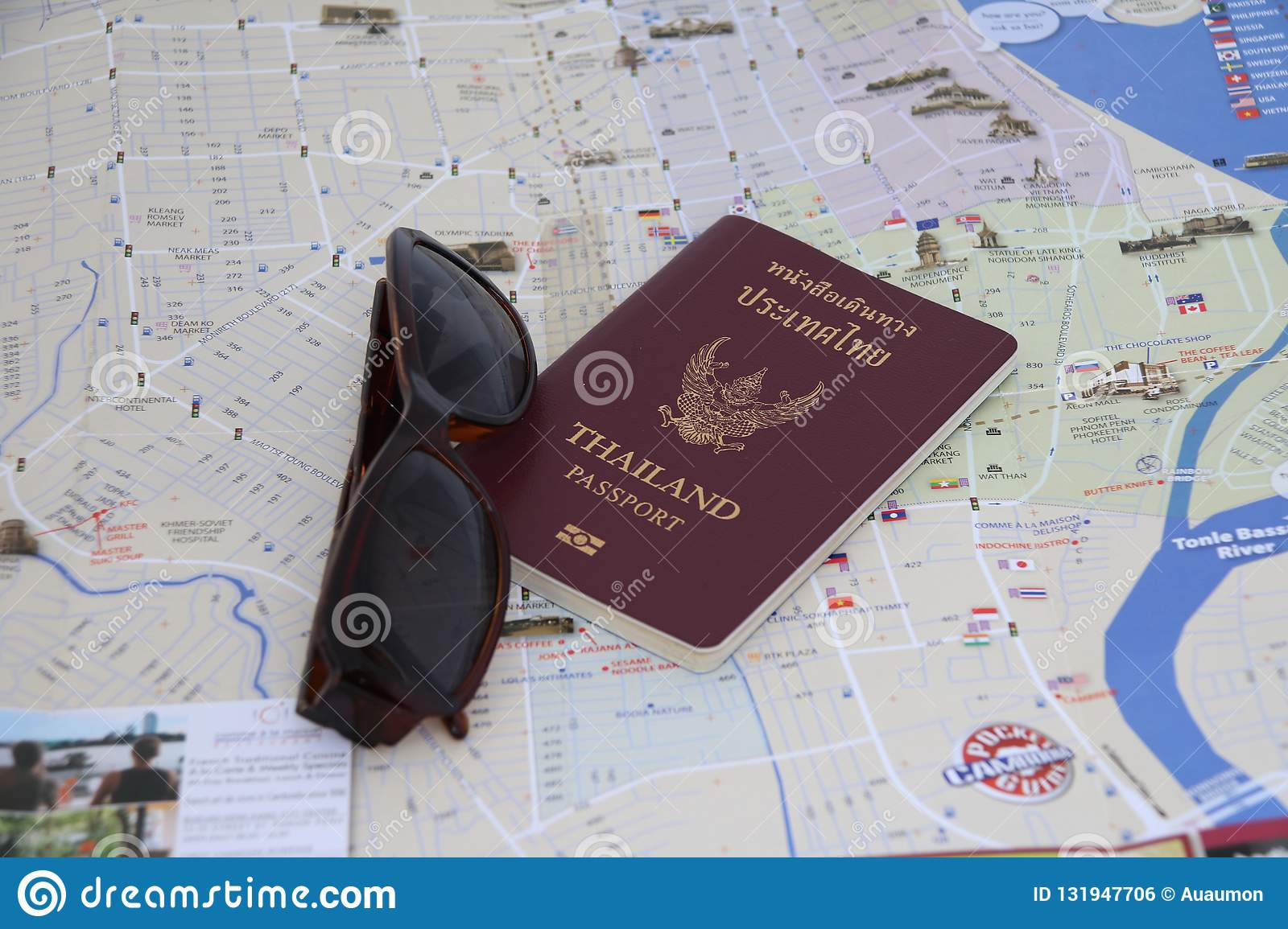 Thailand passport and sunglasses on the map, Prepare to travel.