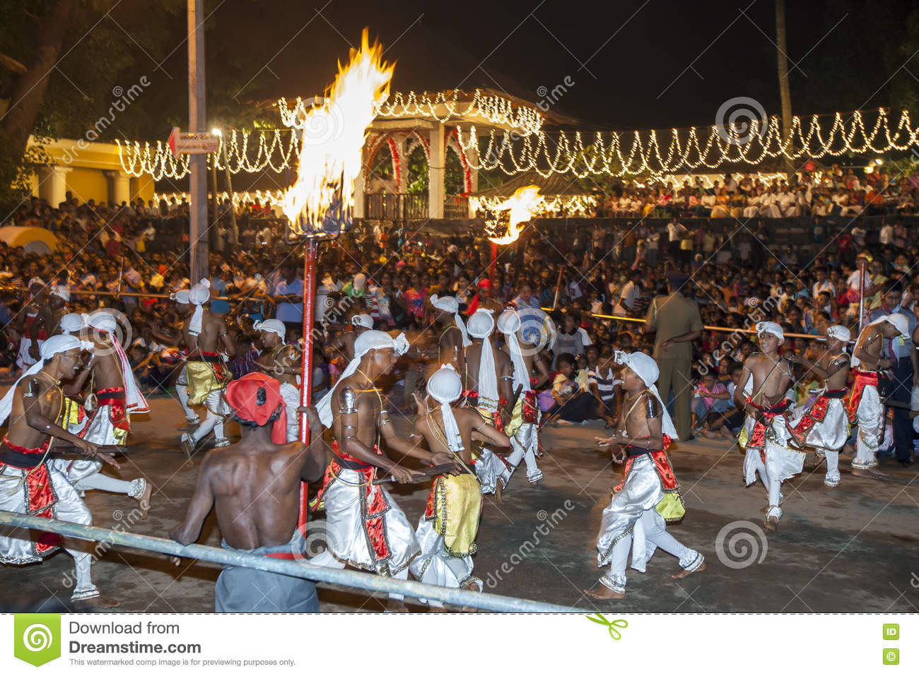 Pathuru Dancers perform in front of a huge crowd at the Esala Perahera in Kandy, Sri Lanka.
