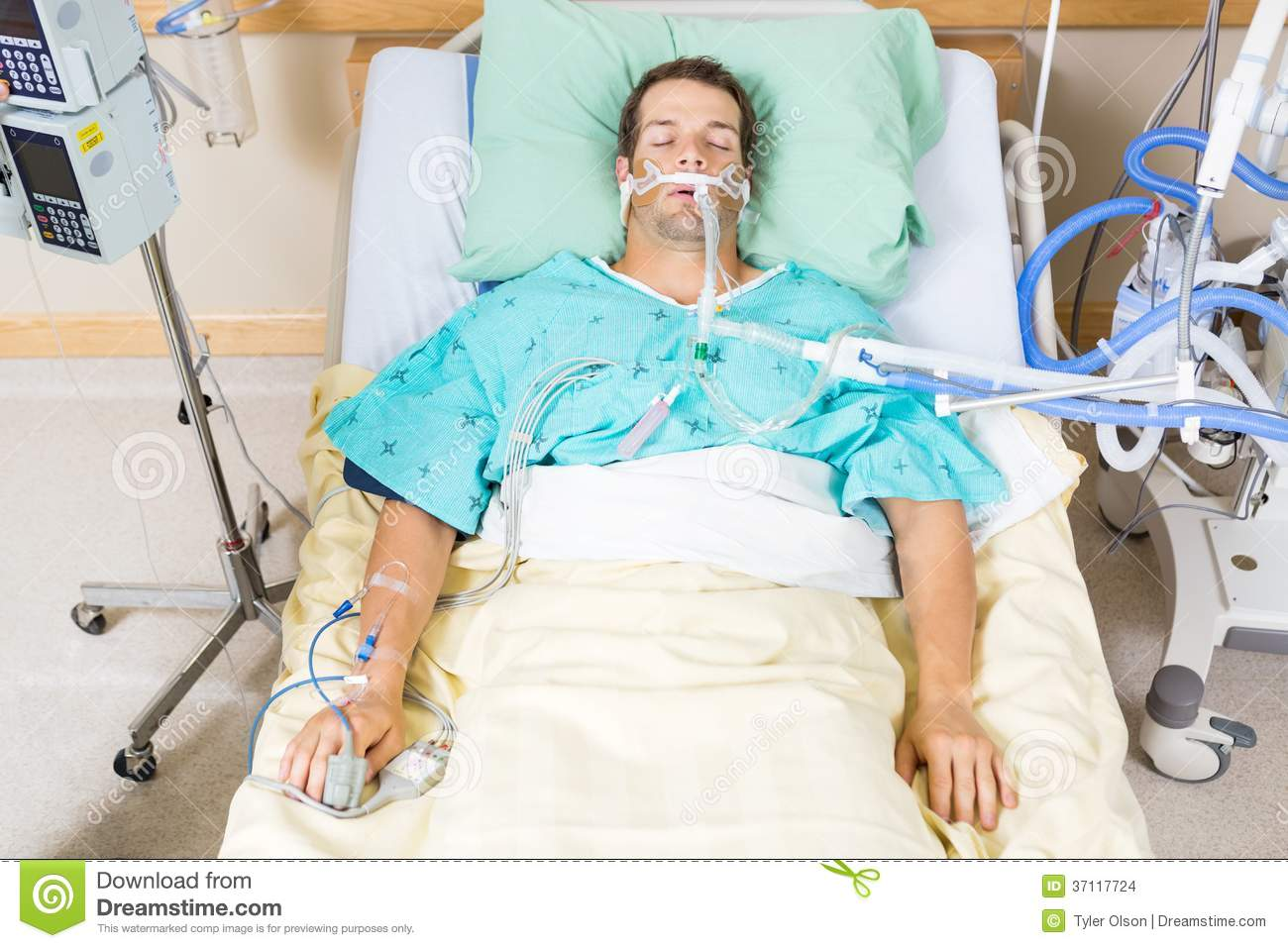 ... of critical patient with endotracheal tube resting on bed in hospital