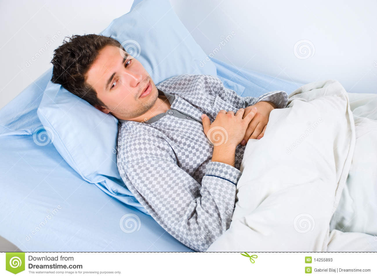 Patient man lying on bed in hospital having pain and looking away,same ...