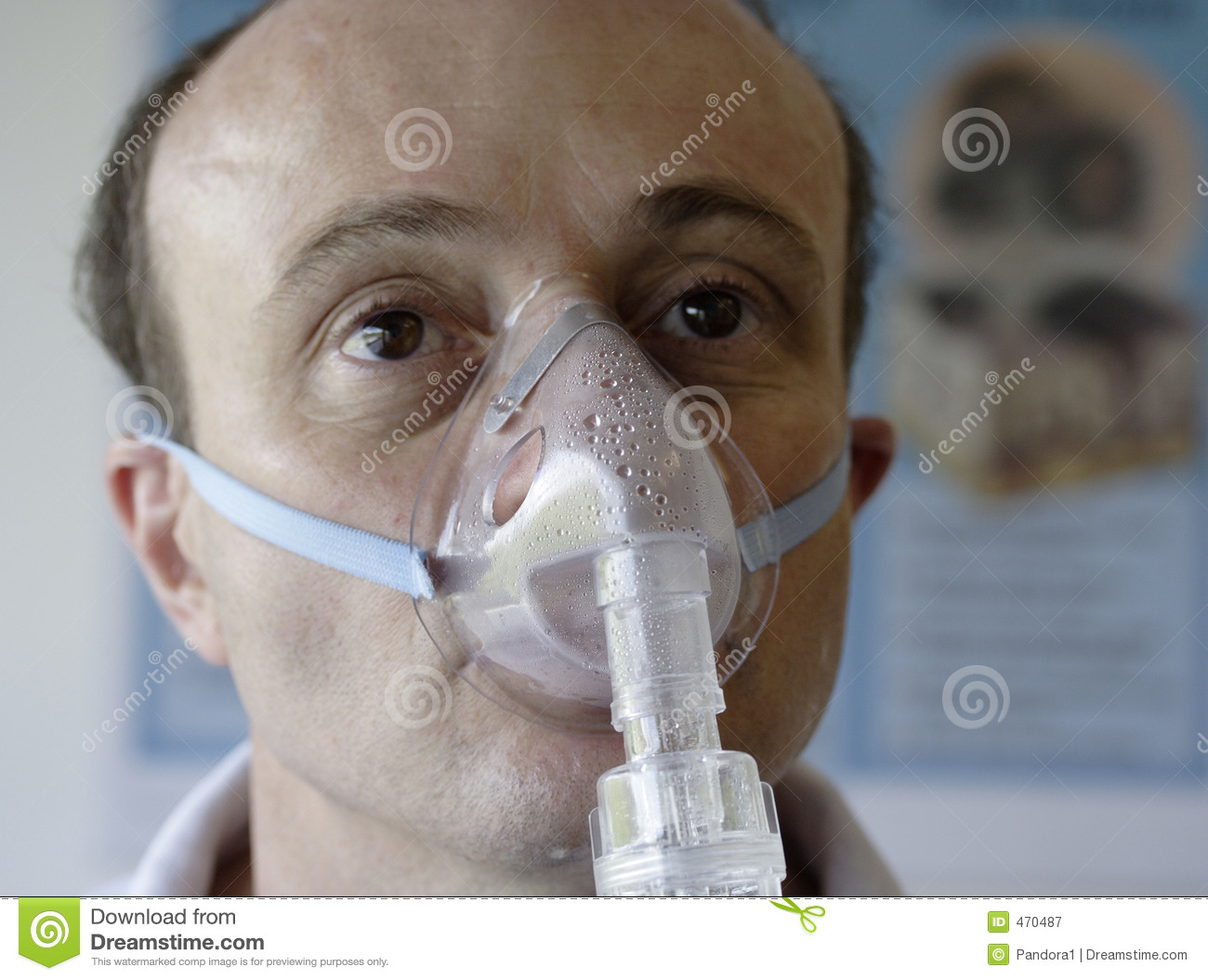 Patient in an oxygen mask