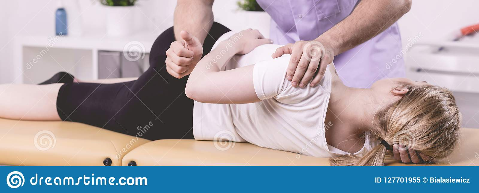 Patient and physiotherapist during rehabilitation in the hospital