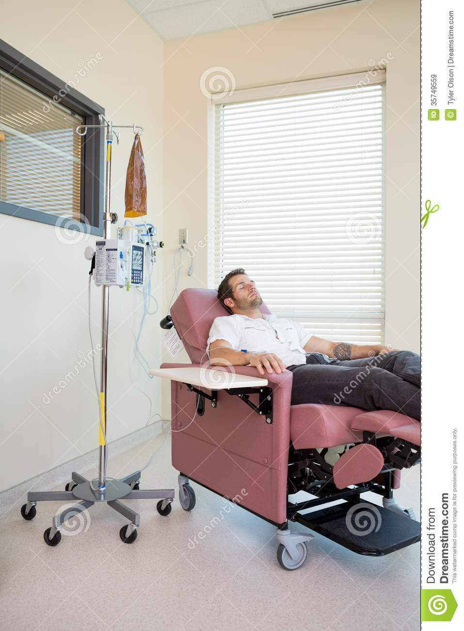 Chemotherapy Room Design: Patient Relaxing During Chemotherapy Royalty Free Stock
